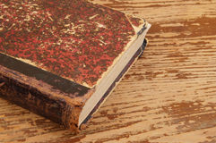 Old book  on wooden background Royalty Free Stock Photos