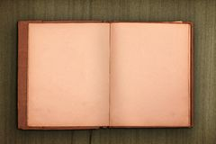 Old book with wooden background Royalty Free Stock Images