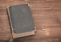 Old book on wooden background stock photos