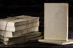 Old book on wooden background. Stacked books on a wooden background, place for text Royalty Free Stock Photo