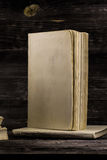 Old book on wooden background. Stacked books on a wooden background, place for text Stock Photo