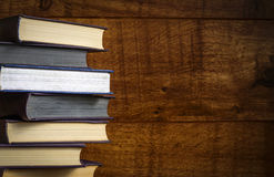 Old book on wooden background. Royalty Free Stock Photography