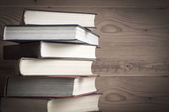 Old book on wooden background. Royalty Free Stock Photos