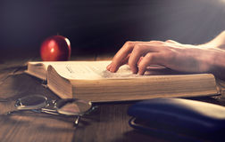 Old book on the wooden boards. Retouching Vintage, selective foc Royalty Free Stock Photography