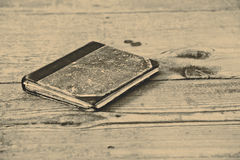 Old book on the wooden floor Royalty Free Stock Photos