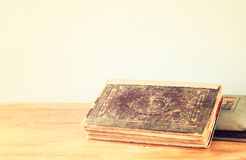 Old book on wooden shelf. Stock Images