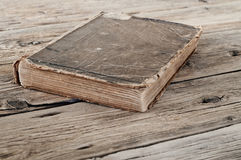 Old book on a wooden table Royalty Free Stock Photography
