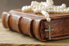 Old book (bible) and the Christian symbol cross Royalty Free Stock Image