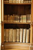 Old bookcase. Old books in a wooden bookcase stock photography