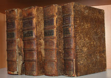 Old books. Bookshelf with old books in one format Royalty Free Stock Photography