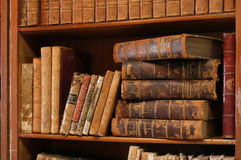 Old books. On a shelf in a library Royalty Free Stock Images