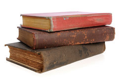 Old Books. Piled together over white background Stock Images