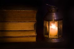 Old books. By the light of a candle old books Royalty Free Stock Photography