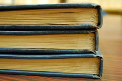 Old Books. A stack of three old books displayed on the table Royalty Free Stock Photo