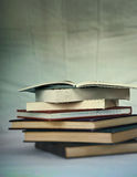 Old Books. A stack of very old books, short depth of field, creative blurs Royalty Free Stock Photo