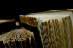 Old books. On a black background Stock Photography