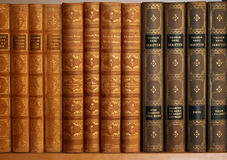 Old books. Old novels on a bookshelf stock photography