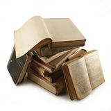Old books. Bunch of old books.Text in that open book is blurred Stock Photography