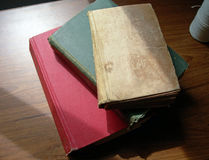 Old books. Stack of old worn books sitting on a table Royalty Free Stock Photos