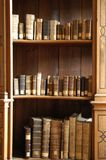 Old Books. Collection of antique books line a bookshelf Stock Images
