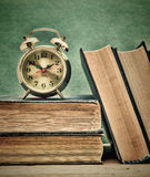 Old books and alarm clock Royalty Free Stock Photography