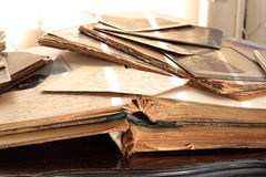 Old books, albums and photos. Old books and photos over hundred years old on antique table Stock Photo