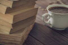 Old books along with a cup of coffe. stock photos