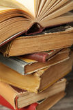 Old books. Old antique books on grey wooden table royalty free stock photography