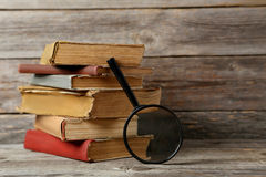 Old books. Old antique books on grey wooden table royalty free stock photo
