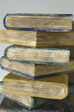 Old books as a pile. Closeup under natural lights Stock Photo