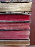 Old books at attic. With colored anil sheets royalty free stock photos