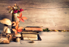 Old books, Autumn decorations on wood, text space Royalty Free Stock Photos