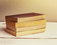 Old Books Background. Books on wooden shelf. Copy space. Vintage style toned ima Stock Photos
