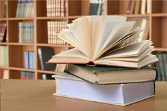 Old books on  background,close up. Ancient books paper art abstract brown dark Stock Photo