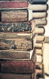 Old books background. Stack of books in a row. royalty free stock photo