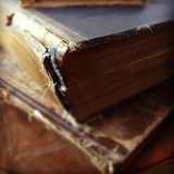 Old books in bad condition. A stack of vintage books shows their frayed, damaged spines Royalty Free Stock Photo