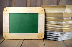Old Books and Blackboard. Stock Images
