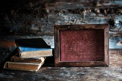 Old books and a blackboard writing on the table. Still life with books Royalty Free Stock Image
