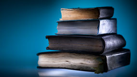 Old books, blue light  background Royalty Free Stock Images