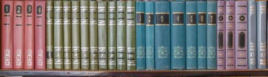 Old books on bookshelf Stock Photos