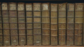 Old books on a bookshelf in the library stock video