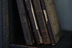 Old books on bookshelf. Old books with vintage bindings and beautiful gilded leather book covers stock photography