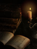 Old books and candle Stock Image