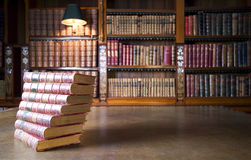 Old books in classic library stock photos