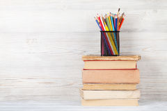Old books and colorful pencils Royalty Free Stock Image
