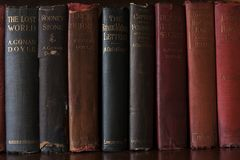 Old books by A. Conan Doyle. Beautiful old books in a bookcase. Author A. Conan Doyle Stock Photography