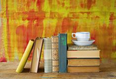 Old books and a cup of coffee. Free copy space Royalty Free Stock Images