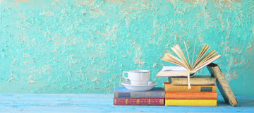 Old books and cup of coffee Stock Images