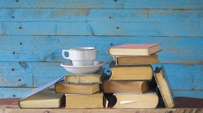 Old books and cup of coffee royalty free stock photography