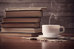Old books with cup of coffee royalty free stock photos